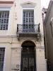 03 Είσοδος του νεοκλασσικού κτιρίου που στεγάζεται η Φιλαρμονική Εταιρία Ωδείο Πατρών (επί της Ρήγα Φερραίου 7)
